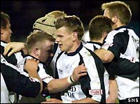 Rory Kerr (centre) celebrates helping Glasgow to victory