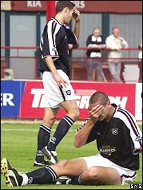Lee Wilkie cannot believe his luck as he scores an own goal