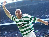 John Hartson's celebrates his deflected goal at Ibrox
