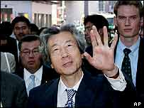 Japanese Prime Minister Junichiro Koizumi gestures in front of the Museum of Checkpoint Charlie in Berlin on 17 August 2003.