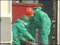 Health inspectors examine meat