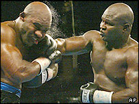 Holyfield (left) could not cope with Toney