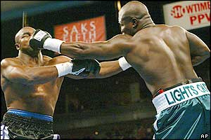 Evander Holyfield (left) starts positively but is soon on the back foot against a rampant James Toney