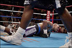 Holyfield hits the floor and his trainer Don Turner asks the referee to end the fight