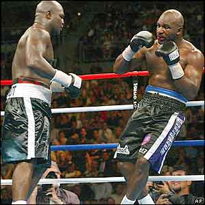 The end is nigh for Holyfield as he is rocked by a flurry of blows midway through the ninth
