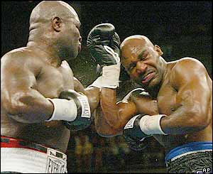 Holyfield's problems begin in the fourth round when Toney unleashes a string of searching punches