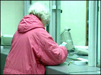 A pensioner at the Post Office counter