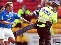 Cowie is restrained as he tried to kick Ricksen