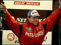 Makinen celebrates his 1998 world title at the Rally of Great Britain