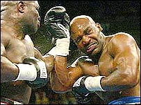 Evander Holyfield takes a pounding from James Toney