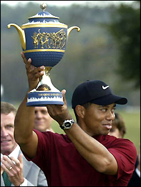 Tiger Woods lifts the American Express Championship Trophy