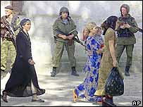 Armed Russian troops watch Chechen voters