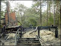 A charred frame is all that is left of the wooden hut which stood in woodland at Holkham
