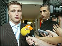 Ralf Schumacher talks to reporters after Tuesday's hearing