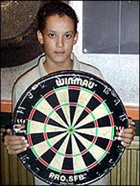 Pascal poses with the dartboard