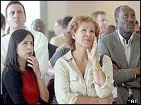 UN workers in New York watch the coverage of the Baghdad blast