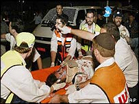 Paramedics tend to a victim of the Jerusalem bus bomb