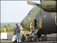 Men stand near a German military plane at Bamako airport