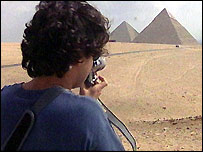 Man takes a photograph at the pyramids