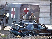US soldiers stand guard at the site of the UN bombing in Baghdad