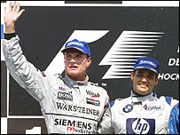 David Coulthard and Juan Pablo Montoya on the podium after the German Grand Prix