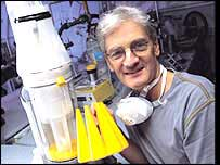James Dyson with the bagless vacuum cleaner he invented