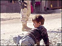 Afghan boy with marine