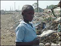 Boy near rubbish in road