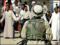 US soldier observes a Shia demonstration in Baghdad