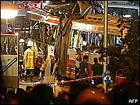 Paramedics inspect the bus where a suicide bomber struck in Shmuel Hanavi, Jerusalem