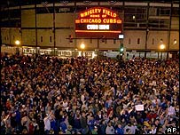 Cubs fans celebrate at Wrigley Field after the Cubs beat the Atlanta Braves