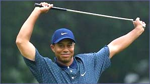 Tiger Woods stretches his arm muscles
