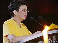 Former Philippine President Corazon Aquino, addressing crowd on eve of anniversary