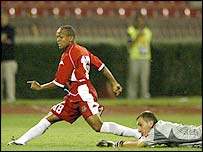 Robert Earnshaw rounds the Serbia & Montenegro only to see his shot stopped by the last-ditch lunge of Mladen Krstajic