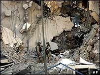 US soldiers inspect the bombed Canal Hotel housing the United Nations headquarters in Baghdad, 20  August 2003