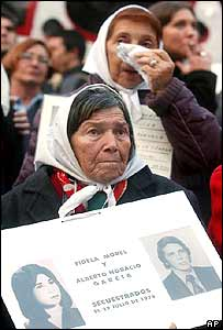 Members of the Argentine human rights group Mothers Plaza de Mayo wait in front of the Congress in Buenos Aires