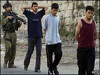 Israeli soldiers arrest Palestinians during a military operation in the West Bank City of Nablus