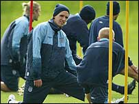 Owen Hargreaves of England (M) stretches with team-mates during England's training session at the Colney Hatch training ground