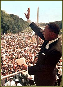Martin Luther King waves to the crowd after making the