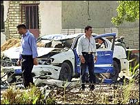 Wrecked police car at bombed police station