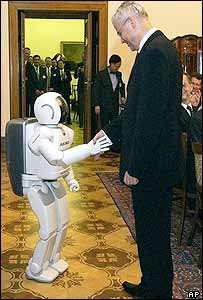 Czech Prime Minister Vladimir Spidla shakes hands with Asimo