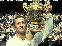 Rod Laver holds up the Wimbledon trophy in 1970