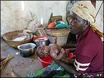 Burundi refugee with baby