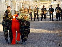 File photo of guards with a detainee at Guantanamo Bay