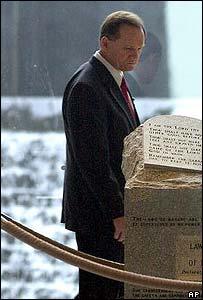 Judge Roy Moore looks at his controversial Ten Commandments block