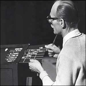 A technician feeds the racing results into their slot in 1969