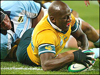Wendell Sailor scores the opening try of the World Cup