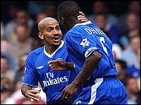 Juan Veron and Marcel Desailly celebrate the opener
