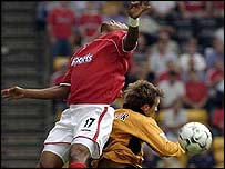 Wolves' Lee Naylor and Charlton's Shaun Bartlett challenge for the ball