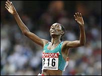 Berhane Adere celebrates victory in the women's 10,000m